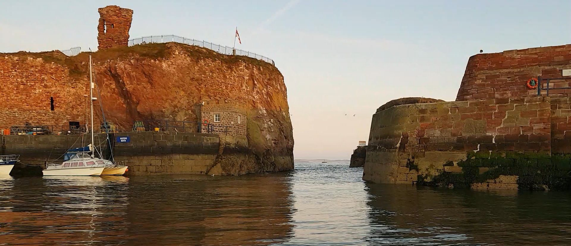 The remains of the old castle on the cliff guard the narrow entrance to Dunbar harbour