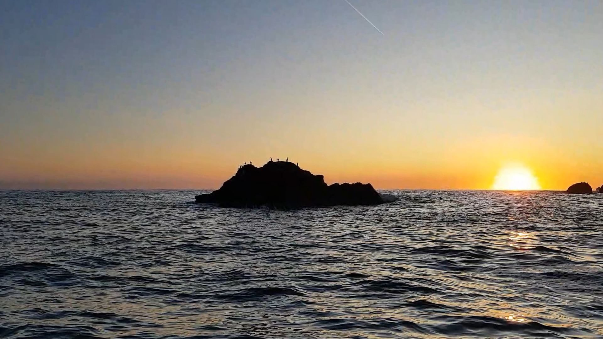 The sun is just appearing above the horizon as I pass the Yett rocks which line the approach to Dunbar harbour