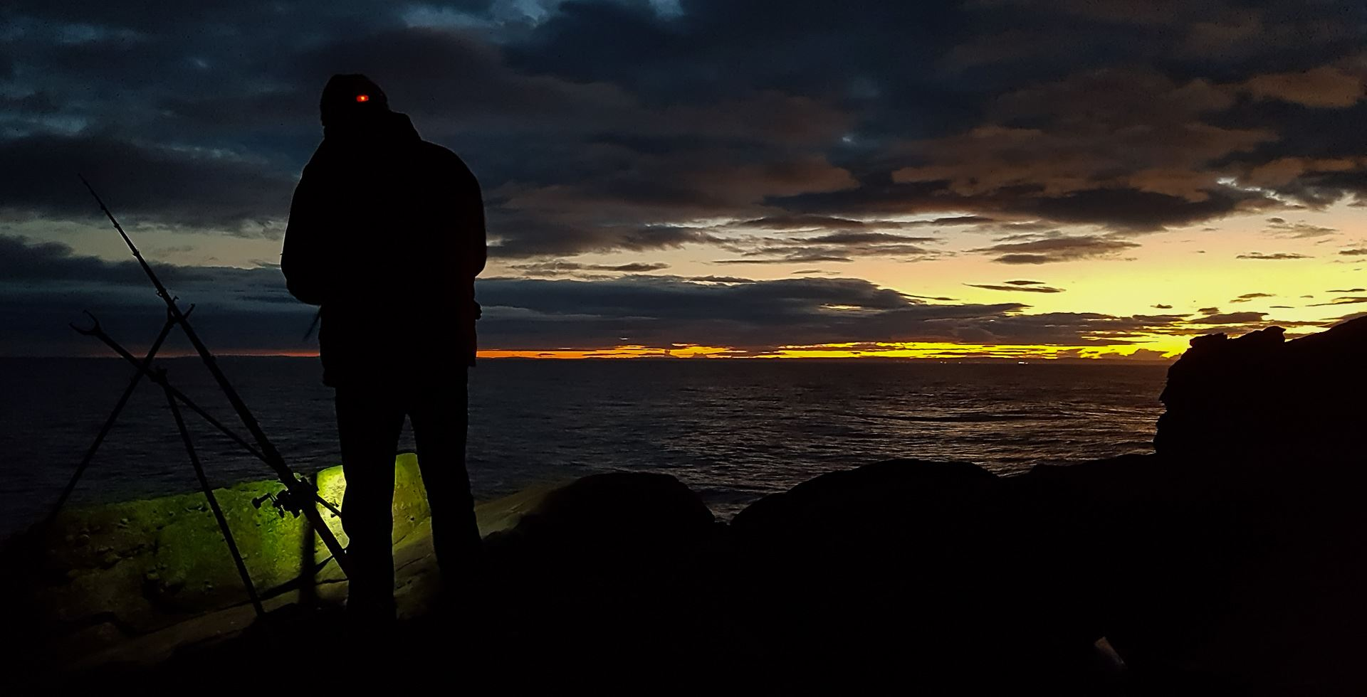 A fine winter sunset on the Arbroath cliffs helps offset a poor day's fishing