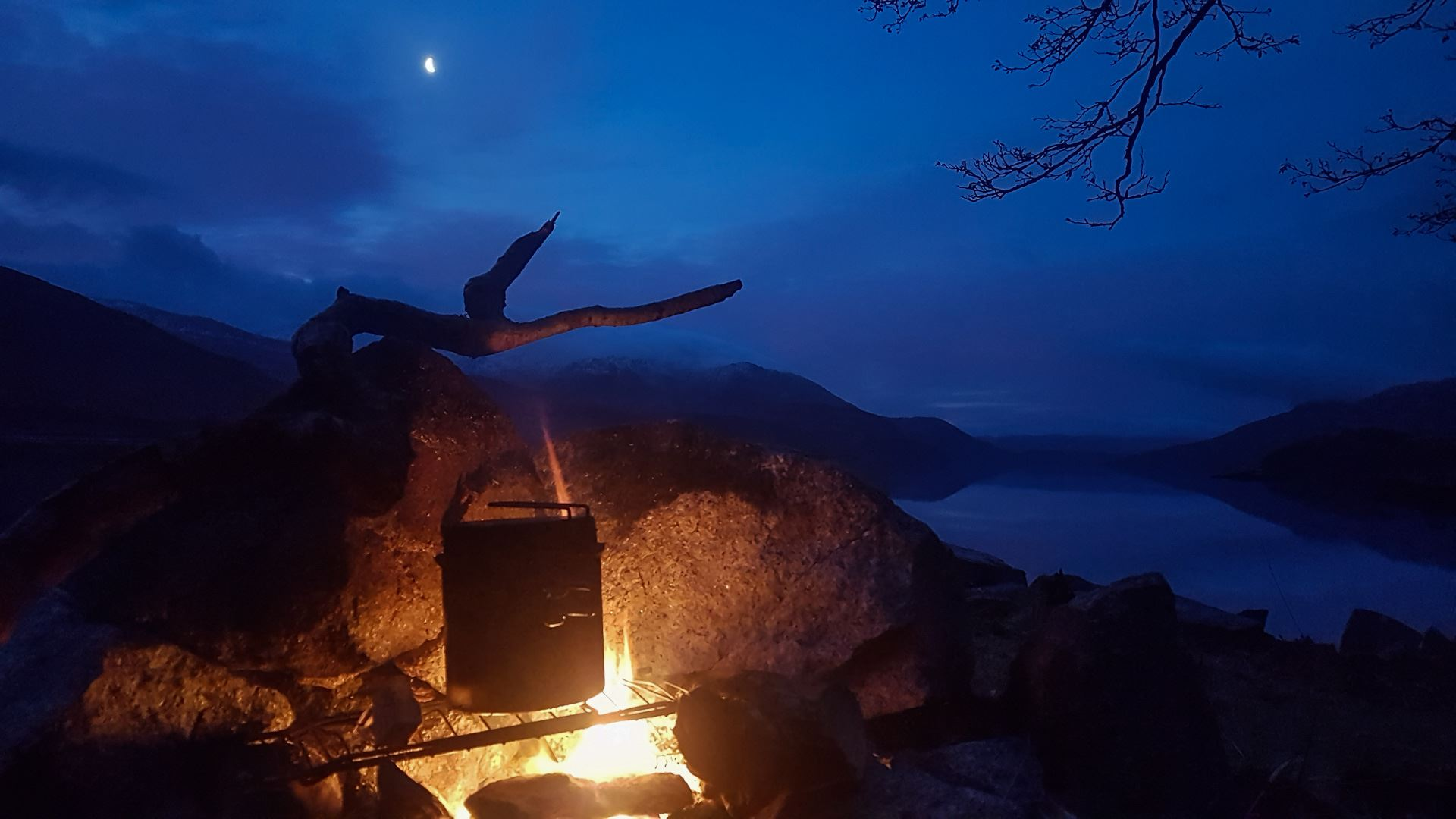 Coffee bubbling away on my campfire in the dawn of a lovely calm January morning. A half moon is still shining over a very still Loch Etive in the western highlands of Scotland